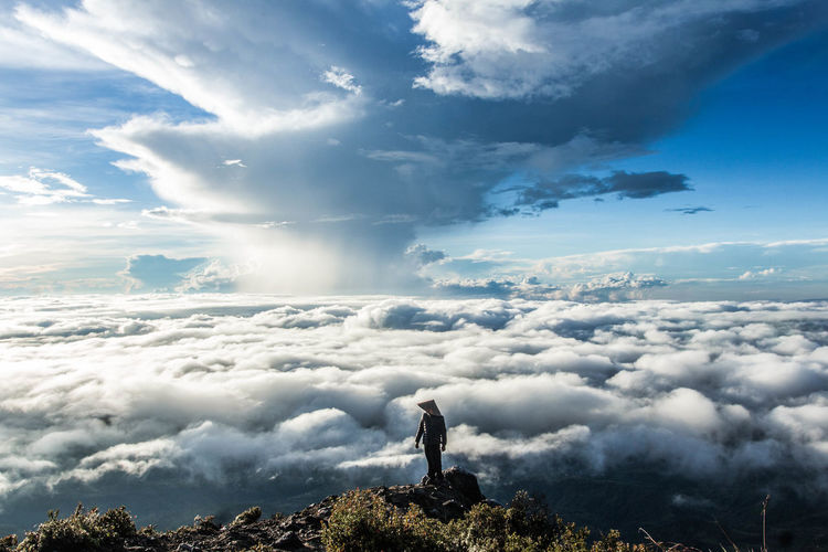 Man Standing Against Cloudscape
