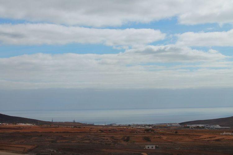 Beach Beauty In Nature Built Structure Cloud Cloud - Sky Cloudy Coastline Day Fuerteventura Horizon Over Water Idyllic Landscape Nature Outdoors Scenics Sea Shore Sky The KIOMI Collection Tranquil Scene Tranquility Water The KIOMI Colllection