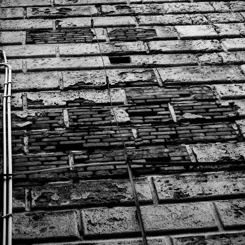 Outdoors No People Built Structure Textured  Building Exterior Architecture Streetphotography Sunday Morning Window Sunday Canon_offical Canoneos1100D Canon1100d Canon_camera Passionforphotography Mywork Wall Wall Textures Bw Bw_collection BW_photography Blackandwhite Blackandwhite Photography Bnw_collection Bnwphotography