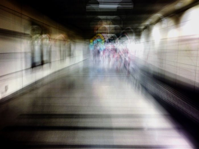 Pedestrians walk in a tunnel towards the Boon Keng MRT station Notes From The Underground Abstract Streetphotography Slow Shutter