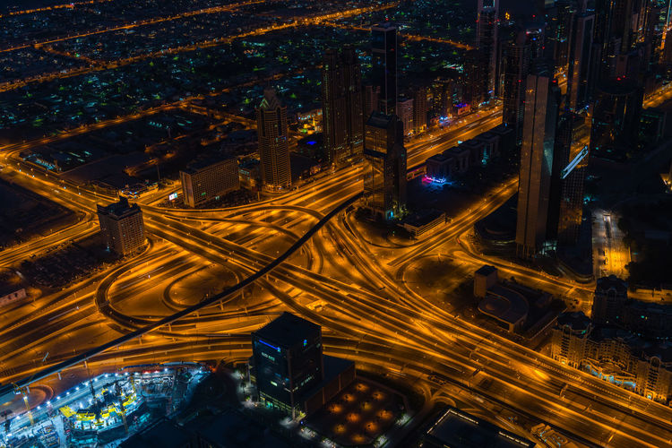 Aerial view of light trails on highway at night