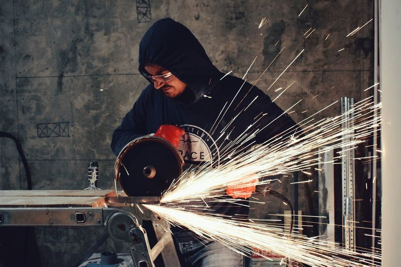 Angle grinder series 🛠 Sparkling Sparks Angle Grinder Working Occupation Welder One Person Welding Protective Workwear Grinder Indoors  Industry Metal Industry Men Real People People Adult Headwear One Man Only Manual Worker Only Men Adults Only Business Stories A New Beginning 17.62°