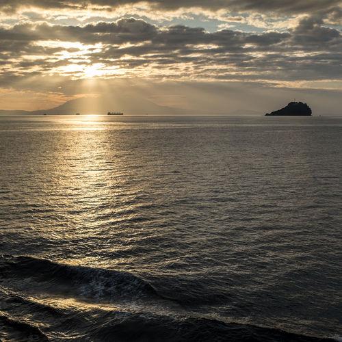 Beauty In Nature Calm Cloud Cloud - Sky Cloudy Coastline Girl Horizon Over Water Nature Non-urban Scene Outdoors Remote Rippled Scenics Sea Seascape Shore Sky Sun Sunbeam Sunlight Sunset Tranquil Scene Tranquility Water