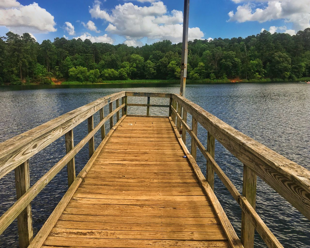 water, sky, tree, lake, cloud - sky, nature, tranquility, tranquil scene, outdoors, pier, beauty in nature, day, scenics, no people, jetty, mountain