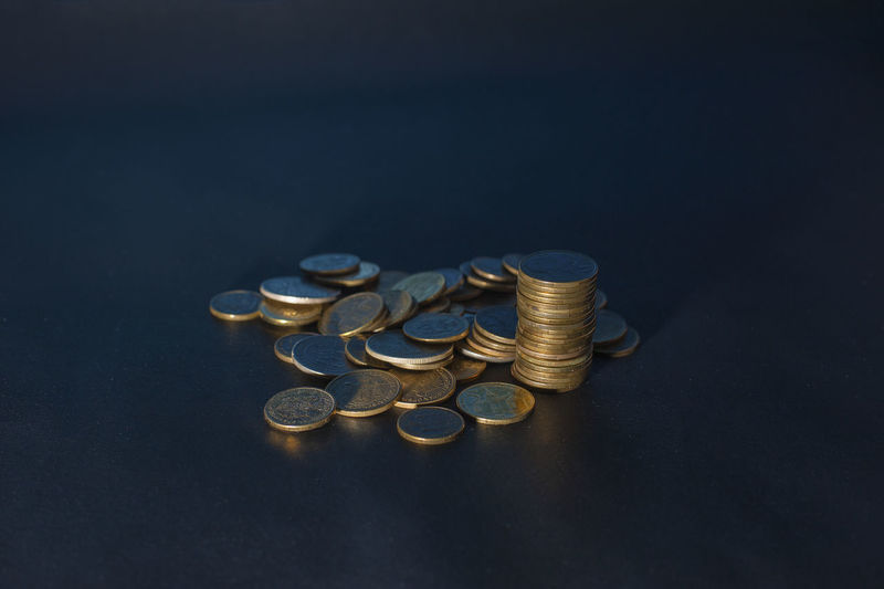 Stack of coins on black background