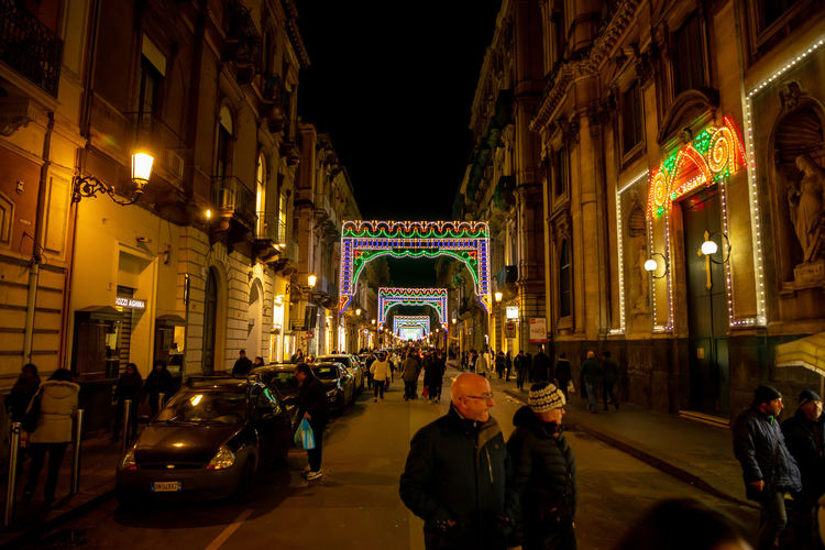 Italy Sicily Architecture Illuminated Night Built Structure Building Exterior City Real People Street Group Of People Transportation Men Mode Of Transportation Women Motor Vehicle Large Group Of People Lifestyles Land Vehicle Crowd Travel Car Light