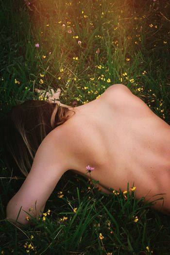 Grass One Person Field Women Leisure Activity Lifestyles Summer Nature Lying Down Real People Outdoors Young Women Beauty Young Adult Day Human Body Part Close-up Adult People Adults Only
