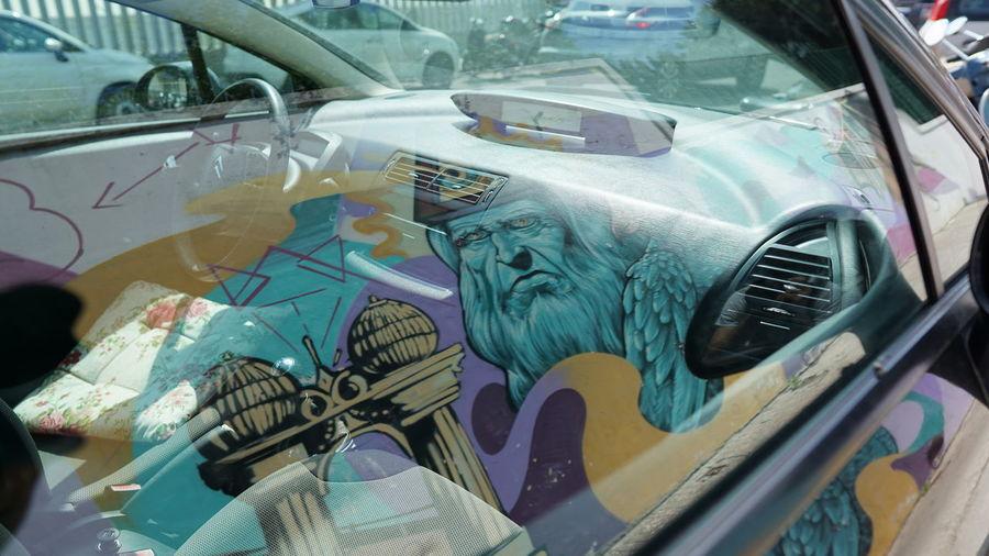 Close-up of graffiti on car