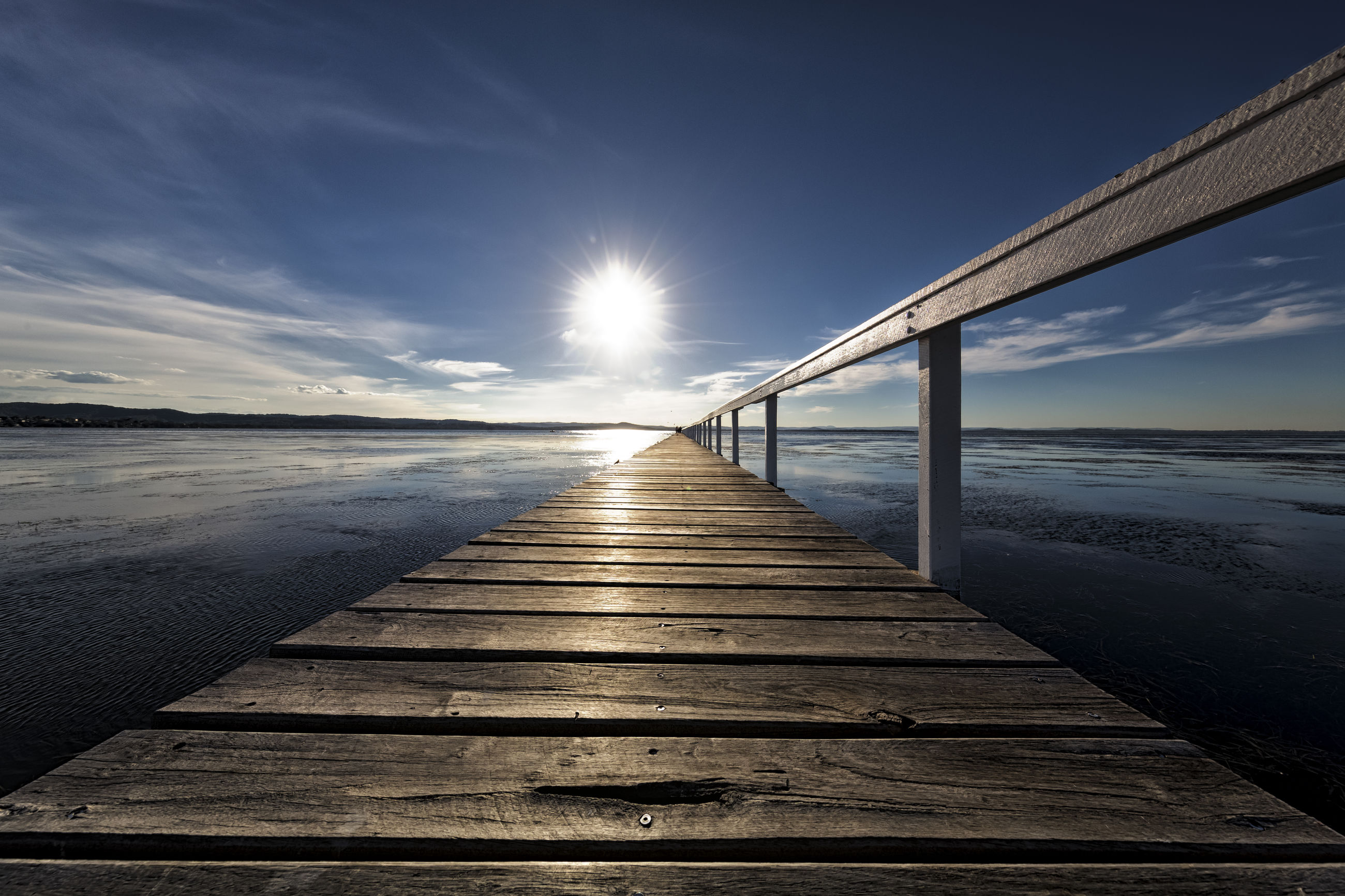 water, sea, pier, sky, sunlight, nature, wood - material, outdoors, beach, scenics, jetty, the way forward, beauty in nature, no people, wood paneling, tranquility, bridge - man made structure, horizon over water, sunset, day