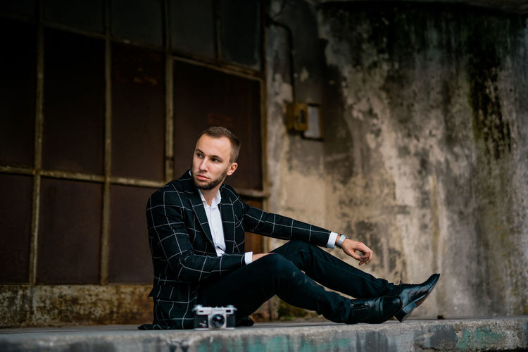 Man Stylish Adult Architecture Bycicle Casual Clothing Contemplation Full Length Jeans Lifestyles Looking Looking At Camera Man Fashion Men One Person Outdoors Portrait Relaxation Retro Style Retro Styled Sitting Style Style And Fashion Wall - Building Feature Young Adult Young Men