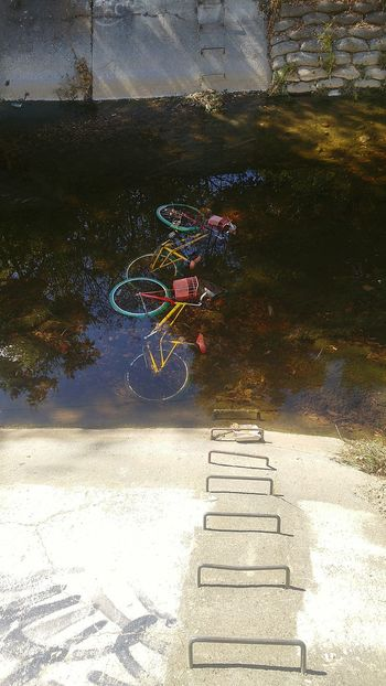 Reflection Wet Water Outdoors Rain Puddle Rainy Season Day No People Oil Spill Nature Sky Bikes Google Bike Drainage Channel Drainage Looking Down Bay Area Man Made Object Urban Landscape Urbex Colors Urban Lifestyle Urban Exploration Scenics Google bikes