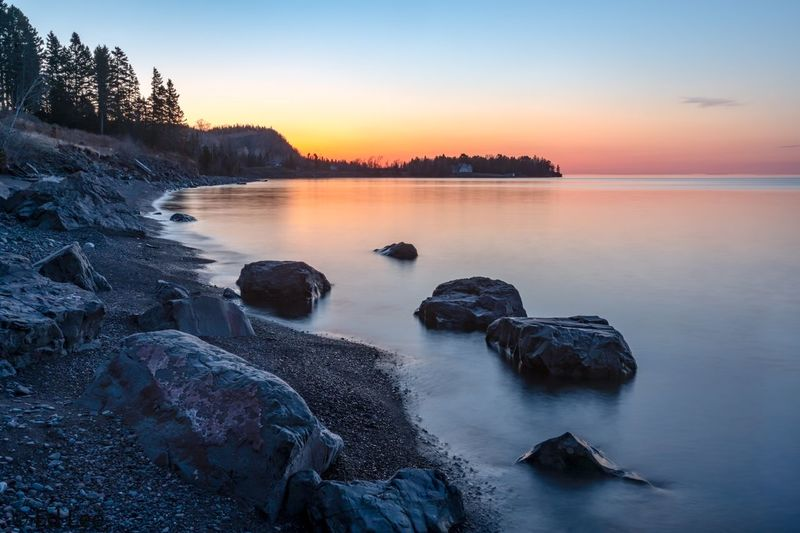 It's a new dawn! Dawn Sunrise Lake Superior Long Exposure Slow Shutter Water Minnesota Malephotographerofthemonth Water Sky Sunset Scenics - Nature Beauty In Nature Tranquility Tranquil Scene Nature Rock - Object Rock Reflection Outdoors No People Clear Sky Orange Color Idyllic