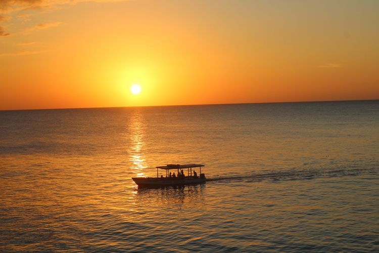 Rickscafejamaica Rickscafe Sunset Jamaica Sunset Sky Water Orange Color Sea Nautical Vessel Beauty In Nature Scenics - Nature Sun Sunlight Outdoors Reflection