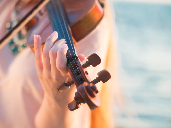 Close-Up Of Hand Playing Violin