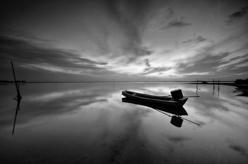 Beautiful early morning on the Jubakar Beach, Tumpat Kelantan. Long exposure nature framing. Reflection Black And White Beach Landscape Fishing Boat Seascape Fine Art Amazing View Black&white Fine Art Photography Black Malaysia Wallpaper EyeEm Nature Lover EyeEm Sunset Sunrise Backgrounds Kelantan Blackandwhite Water Sky Cloud - Sky Boat Standing Water