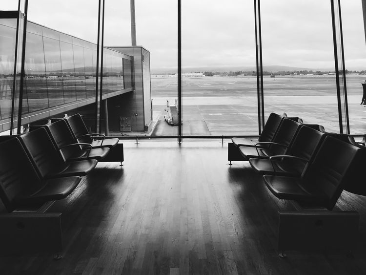 At the AirPort Interior Interior Design Monochrome Blackandwhite Photography Blackandwhite Airport Window Airport Transportation Travel Indoors  Airport Departure Area Chair No People Journey Built Structure Travel Destinations Seat Modern Airplane Architecture Tourism