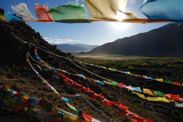 Colorful Prayer Flags Hanging Over Mountains