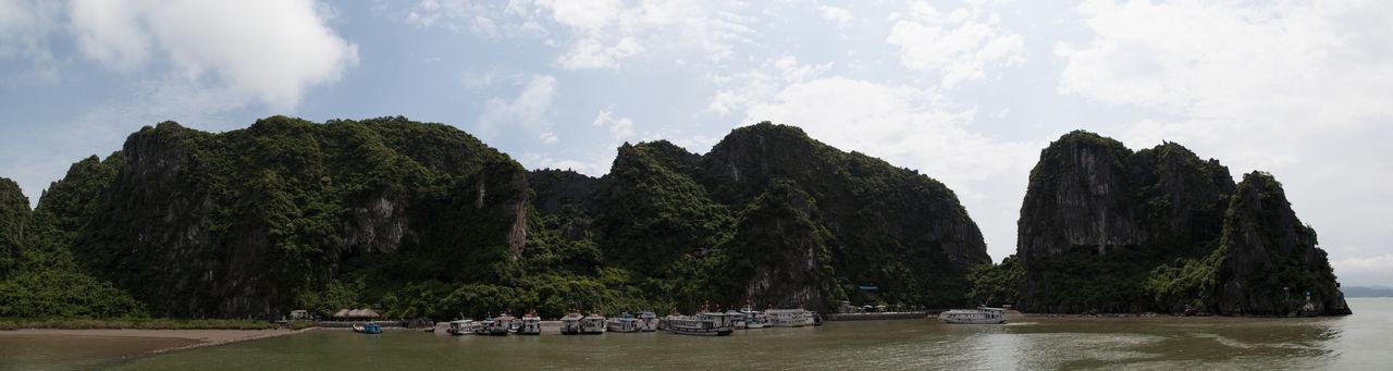 Halong Bay Vietnam Sightseeing Tourist Adventure Boats Destination Hot Spot Karst Rock Land Mountain Nature Nautical Vessel Ocean Panoramic Rock Sea Ships Sky Tourism Travel Destinations Water