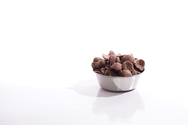A Coco in a steel bowl over white backgroun Archival Breakfast Close-up Coco Coco Crunch Time With JM Copy Space Cornflakes Indoors  No People Serial, Studio Shot Table White Background