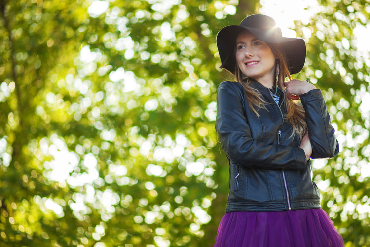 Artistic and natural portrait of beautiful woman in the nature. Woman Face Portrait Beautiful Beauty Smile Female Girl Young Hair Natural Nature Outdoors Skin White Happy Attractive Background Lifestyle Fashion Cute Green Tree Hat Leather Jacket One Person Clothing Lifestyles Leisure Activity Smiling Plant Young Adult Real People Young Women Casual Clothing Day Looking At Camera Front View Sunlight Standing Happiness Emotion Beautiful Woman Hairstyle