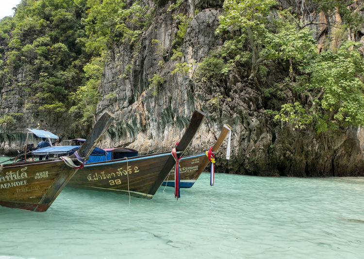 Water Transportation Tree Nautical Vessel Mode Of Transportation Longtail Boat Plant Day Nature Scenics - Nature Beauty In Nature Sea Land Waterfront Moored Mountain Outdoors Non-urban Scene Tranquility Turquoise Colored Thailand