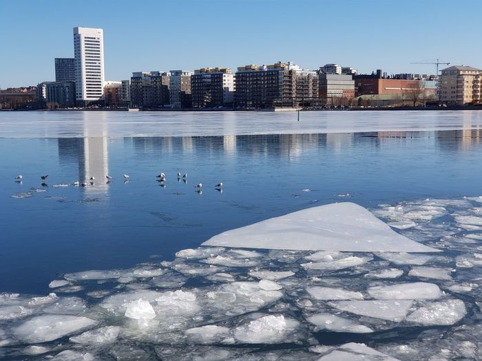 Ice EyeEm Selects City Cityscape Water Skyscraper Urban Skyline Beach Modern Sky Architecture Building Exterior Horizon Over Water Calm Waterfront Frozen Lake Office Building Seascape