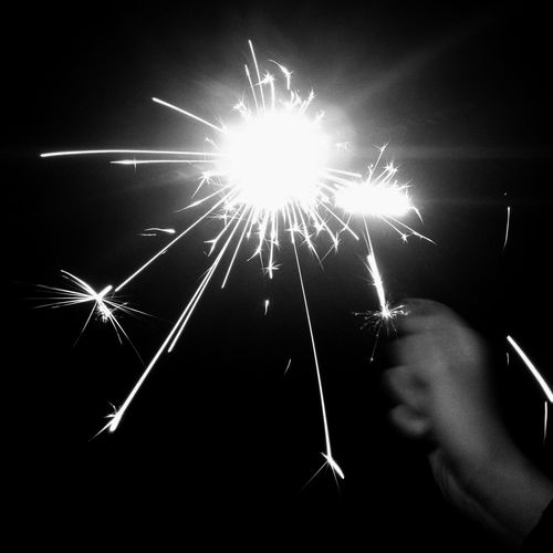 Arts Culture And Entertainment Blurred Motion Celebration Dark Exploding Firework Glowing Holding Human Hand Illuminated Long Exposure Minimal Minimalism Monochrome Motion Night Night Lights One Person Outdoors Sparkler Sparkler Sparkler In Hand Sparks New Year Christmas Celebration