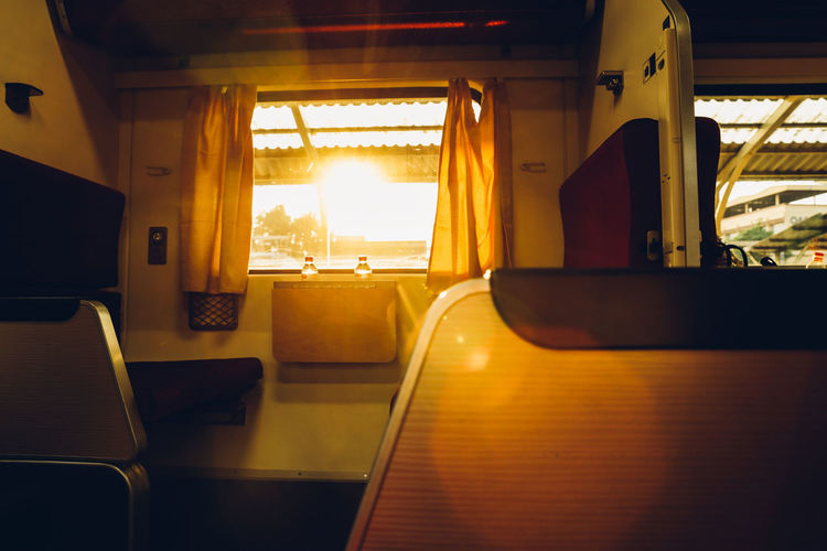 wanderlust in the train Travel Wanderlust Absence Aroundtheworld Day Empty Glass - Material Indoors  Luxury Mode Of Transportation Nature No People Public Transportation Rail Transportation Railway Seat Sunlight Sunset Train Transparent Transportation Travel Vehicle Interior Vehicle Seat Window