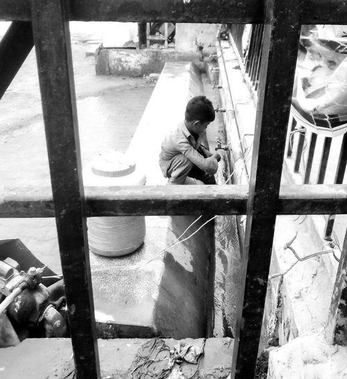 Blackandwhite Child Framed Faucet Water Child Labor  The Portraitist - 2018 EyeEm Awards