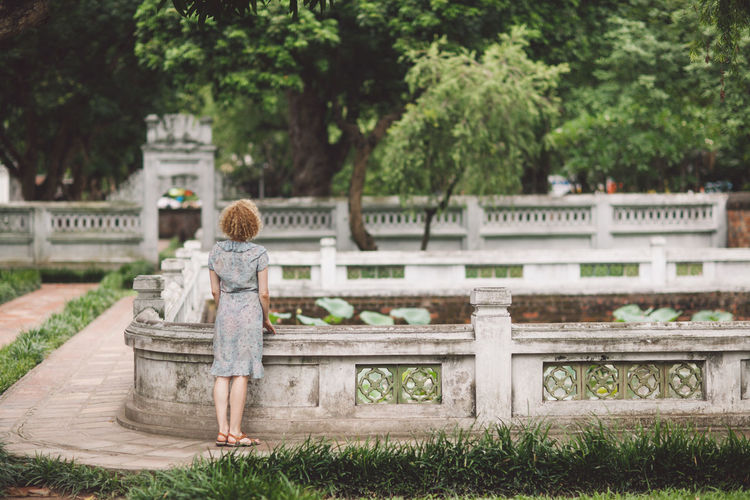Rear view of woman standing in park