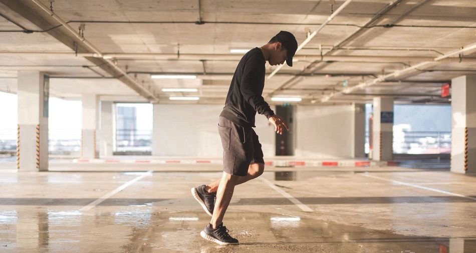 Full length of man standing in parking lot