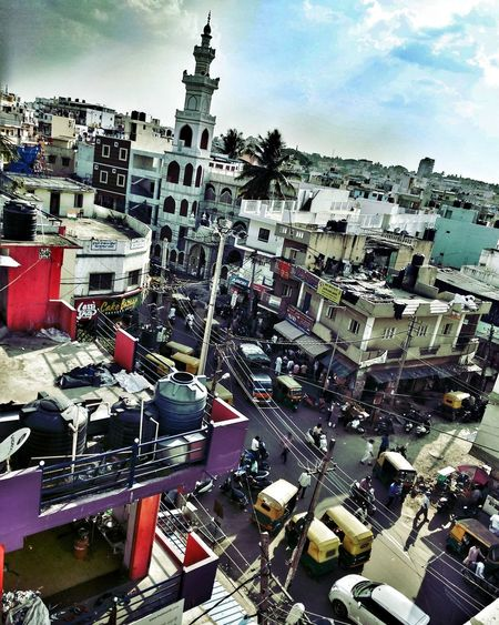 #A_City_of_Differences India Bangalore Bangalore Bangaloredairies Masjid India People Narrow Narrow Street Color Colorful City Colorful Indiapictures City Cityscape Sky Architecture Building Exterior Cloud - Sky Financial District  Residential District Human Settlement Settlement Crowded Row House Residential Building