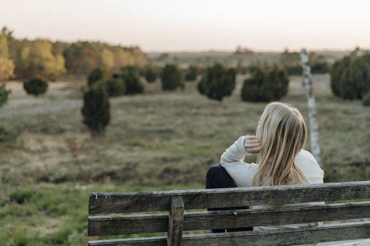 Portrait of woman sitting on land