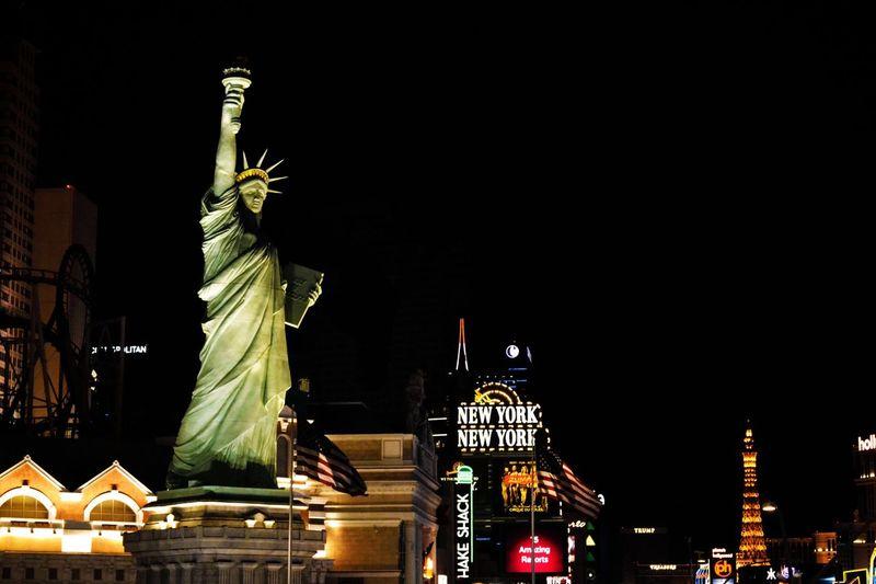 New York New York Casino in Las Vegas Statues And Monuments New York New York Casino Newyoknewyork Las Vegas At Night Las Vegas Lasvegas Casino Architecture Night Sculpture Illuminated Statue Built Structure Representation Building Exterior Tourism Travel