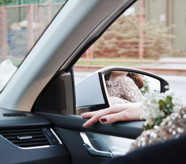 Driving in a car. Woman Fashion Vehicle Dress Hand Nailpolish Rear View Mirror EyeEmNewHere Human Hand Technology Young Women Driving Car Car Interior Steering Wheel Road Trip City Vehicle Seat Windshield Passenger Seat A New Perspective On Life