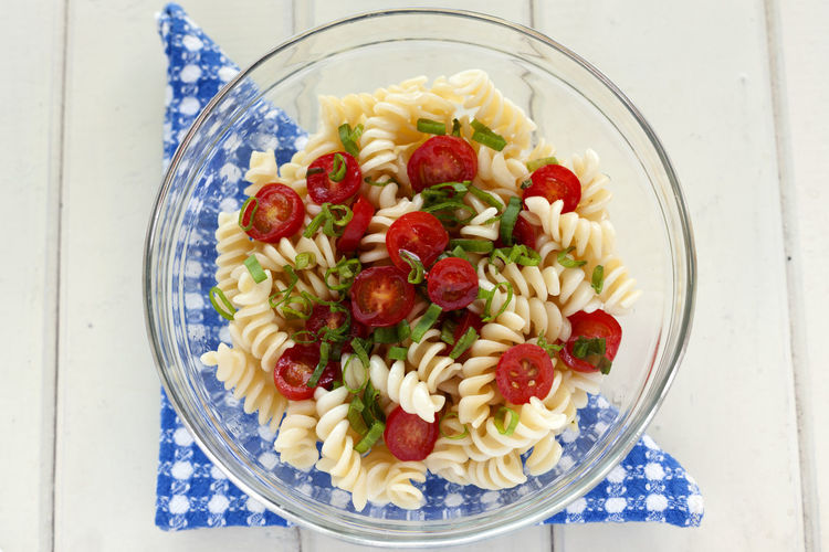 Fresh pasta and cherries tomatoes salad with green onion! Blue Napkin Bowl Cherries Tomatoes Close-up Day Food Food And Drink Freshness Fuchile Fusili Fusilli Glass Bowl Green Onion Healthy Eating High Angle View Indoors  Italian Food No People Pasta Pasta Salad Ready-to-eat Salad Salad Tomato White Background Food Stories