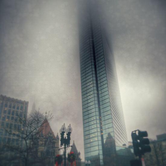 I love this building. Johnhancocktower Boston CopleySquare Copley Square Fog Foggy Architecture