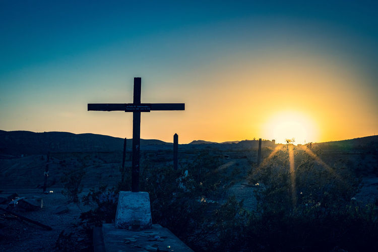 Scenic view of cross against sky during sunset