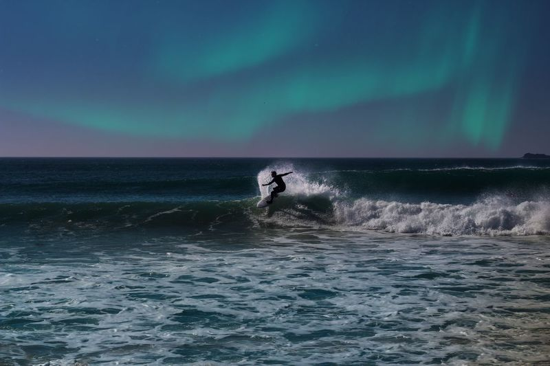 Water Sea Scenics Real People Beauty In Nature Waterfront Lifestyles Leisure Activity Men One Person Outdoors Motion Surf Nature Sky Horizon Over Water Surfboard Wave Adventure Sport Northern Lights First Eyeem Photo Fresh On Market 2017