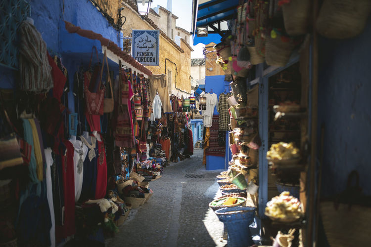 Alley Architecture Building Exterior Built Structure Business Choice City Day For Sale Hanging Incidental People Large Group Of Objects Market Market Stall Outdoors Real People Retail  Retail Display Sale Shopping Small Business Street Street Market Variation Women