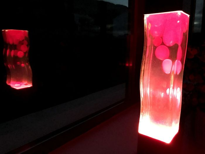 Lava lamp and reflection in a window Lava Lamp Lavalamp Lavalampe Black Background Red Illuminated Close-up Red Light Glowing