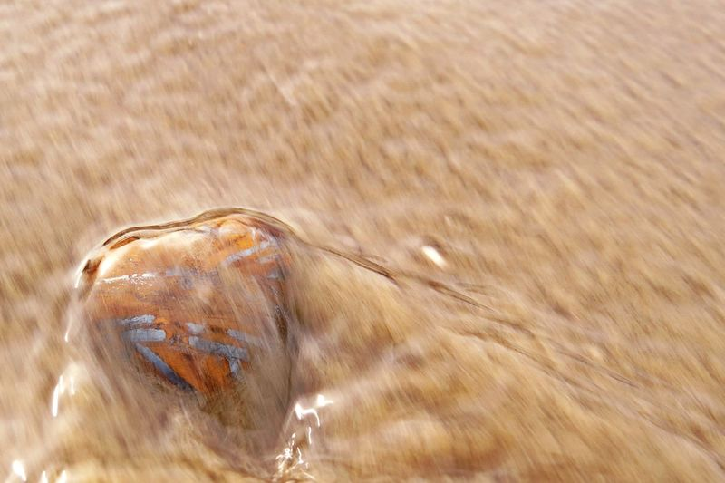 Love Tiger Eye Stone Beach Beauty In Nature Beauty In Ordinary Things Close-up Day Gemstones Heart Heart Shape Love ♥ Nature No People Outdoors Sand Water Water Flow