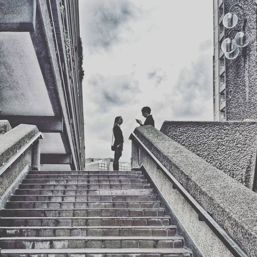 Low angle view of people walking up stairs