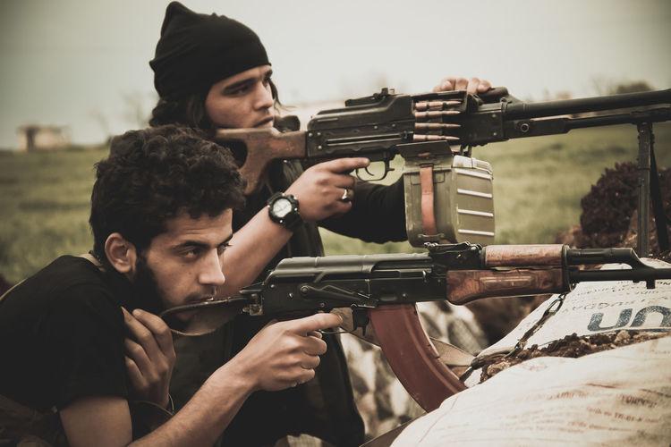 Rebels using rifle during war