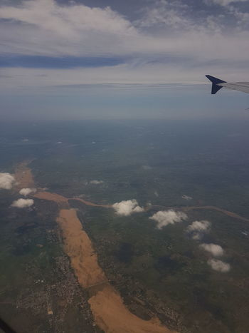 Aerial View Air Vehicle Airplane Airplane Wing Beauty In Nature Cloud - Sky Day Flying Landscape Mid-air Nature No People Outdoors Scenics Sea Sky Transportation Water