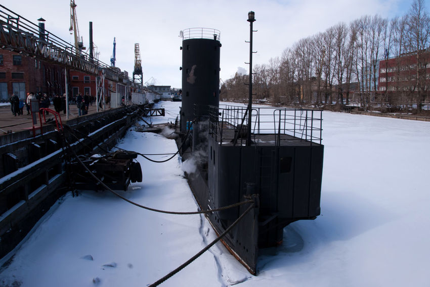 """The launch of the research vessel """"Akademik Tryoshnikov"""" at the St.Petersburg Admiralty Shipyard, March 29, 2011 Blue Bridge - Man Made Structure Cold Temperature Day Frozen Ice Coffee Launch Of The Vessel Moored Nature Nautical Vessel No People Outdoors Shipyard Shipyard Crane Shipyardlife Sky Snow Sunny Water Winter Winter"""