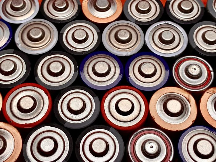 Batteries Battery Full Frame Large Group Of Objects Backgrounds No People Arrangement Multi Colored Indoors  Abundance Stack Aerosol Can Still Life Repetition Pattern In A Row Side By Side Container Close-up Paint Industry Order