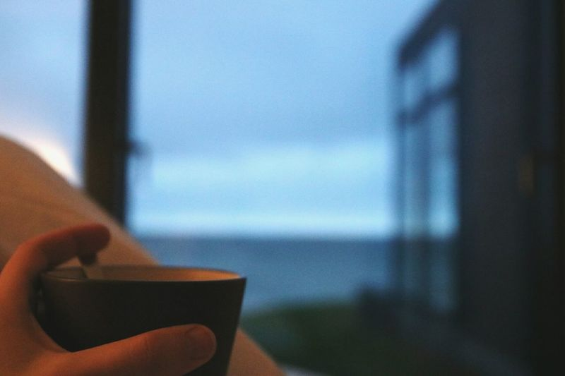 Tea with a view. Dawn Nature Day Fall Beauty In Nature Bright And Early Autumn Rise And Shine Sea Sea And Sky Seascape Seaside Window View Window Tea Hot Drink Clouds Building Exterior Building Horizontal Morning Black Wood Close-up Horizontal Indoors