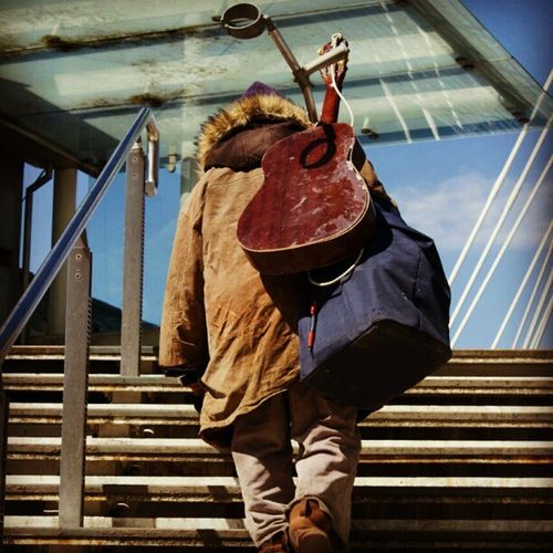 This photo was taken on the way back from the London eye this Guy walked by me and Lindsay and you could tell this Guy had it rough and was struggling to get by in life he got on the bridge set up and started to play to earn money to survive