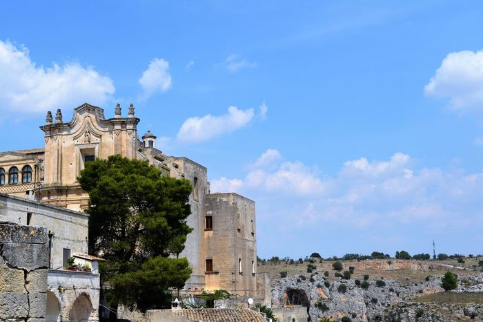 Ancient Architecture Bell Tower - Tower Blue Building Exterior Built Structure Castle Cloud Cloud - Sky Day Famous Place Fort Historic History International Landmark Matera Old Buildings Outdoors Place Of Worship Sassidimatera Sky The Past Tourism Tower Travel Destinations